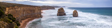 A Large Panorama Of The Evening View Of The Ocean And Twelve Apostles Sea Rocks Near Great Ocean Road, Port Campbell National Park, Australia