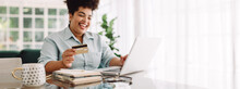 Woman Doing Online Shopping On Laptop