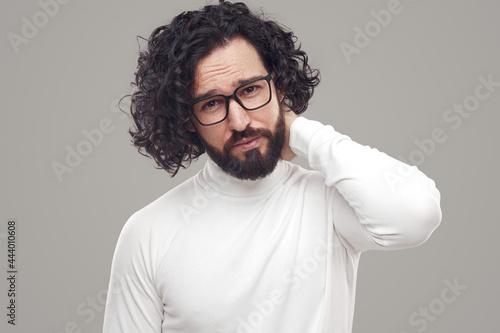 Confident bearded man in eyeglasses looking at camera Fotobehang