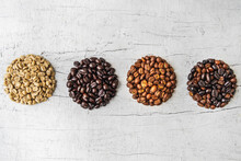 A Collage Of Coffee Beans Showing Various Stages Of Roasting From Green Beans Through To Roast