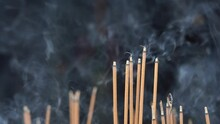 Close-up Of Incense Sticks Burning With Smoke In Buddhist Temple Of Danang City, Vietnam