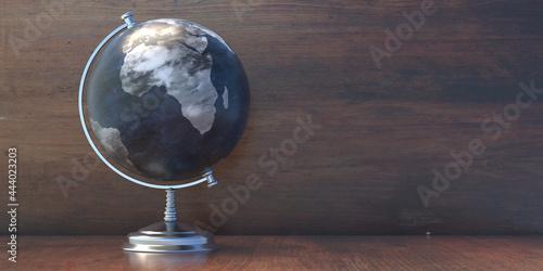 Fotografie, Obraz Globe school planet Earth on wooden background, copy space
