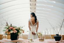 Elegant Bride Standing In Hall With Wedding Decoration