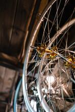 Bicycle Wheels On Rack In Workshop