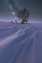 Milky Way In Sky Over Snowy Terrain