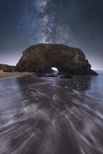 Rock On Seashore Under Starry Sky