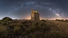 Starry Sky With Milky Way Above Ruined Tower