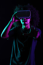 Amazed Ethnic Man Interacting With Virtual Reality In VR Headset