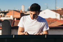 Man Playing Music Keyboard On A Rooftop