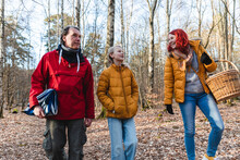 Family Gathering In Autumn Forest For Picnic