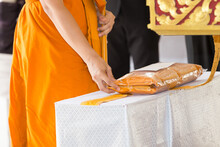 Hands Of Buddhist Monks Holding Robes At Thai Buddhist Funerals