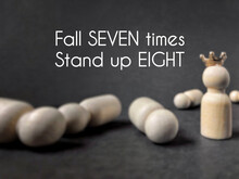 Motivational And Inspirational Concept Quote - Fall Seven Times Stand Up Eight Text Background. Stock Photo.