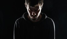 Evil Maniac Or Stalker At Night On Black Background.