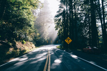 Car Driving Through Empty Road