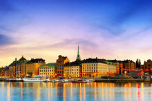 Scenic Summer Sunset Panorama Of The Old Town Gamla Stan Architecture In Stockholm, Sweden