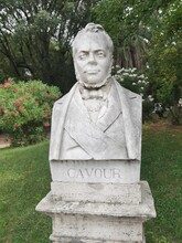 Marble Bust Of The Count Of Cavour, Italian Politician And Patriot. The Bust Is Publicly Displayed In The Gardens Of The Pincio In Rome. Below There Is The Engraved Name.