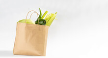 Delivery Healthy Food Background. Vegan Vegetarian Food In Craft Paper Bag.Grocery Shopping Food Supermarket And Clean Eating Concept
