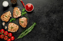 Grilled Skinless Chicken Thighs With Spices And Herbs On A Stone Background With Copy Space For Your Text
