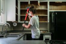 Woman Working On Remodeling Outdated Kitchen.