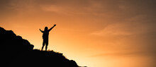 Young Man Feeling Free On A Mountain Top.
