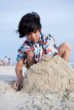 Cute Beautiful Asian Girl Playing Sand Sculpture On The Beach By The Sea