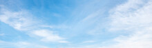 Fluffy Cirrus Clouds At Light Panorama Sky Background