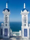 Fototapeta Kawa jest smaczna - View Of Building By Sea Against Blue Sky