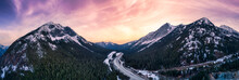 Aerial Panoramic View Of A Scenic Highway Passing In The Canadian Mountain Landscape. Dramatic Sunset Sky Art Render. Taken Near Hope And Merritt, British Columbia, Canada.