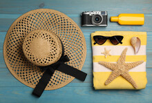 Flat Lay Composition With Beach Objects On Light Blue Wooden Background