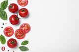 Composition with fresh basil leaves and tomatoes on white background, flat lay. Space for text