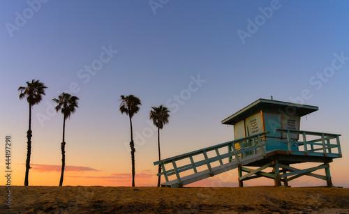 Fotografie, Obraz Lifeguard Hut On Beach Against Clear Sky During Sunset