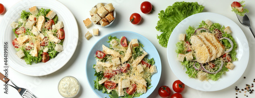 Fotografie, Obraz Concept of tasty eating with Caesar salad on white background