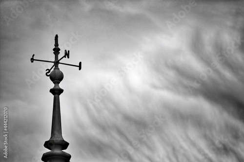 Low Angle View Of Weather Vane Against Cloudy Sky Fototapete