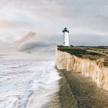 Lighthouse On The Edge Of A Rocky Coast.