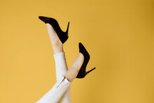 Womens Shoes Upside Down Posing Cropped View Yellow Background
