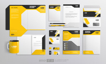 Corporate Brand Identity Mockup Set With Black And Yellow Design. Business Stationary Elements Mockup Template. Abstract Geometric Graphics On Folder, Guide, Annual Report Cover, Brochure