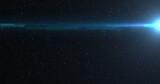 Blue spot of light glowing in the night sky