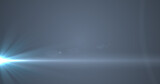 Glowing blue rays of light moving against grey background