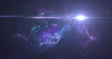 Glowing white spot of light and blue and pink nebula moving in the night sky