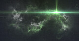 Bright green spot of light moving over white and green nebula in the night sky