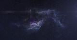 Bright white spot of light moving over white and blue nebula in the night sky