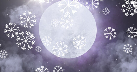 Snow particles falling against moon in night sky