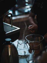 Close-up Of A Barista Making Coffee In A Purover