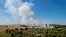 Landscape Of Rubish Dump Burning In The Countryside. Problem Of Ecological Polution