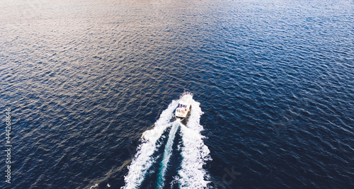 Canvastavla Aerial view of boat crossing tranquil blue sea water surface during winter seaso