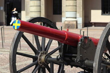 Swedish Flag On Canon In Stockholm On Holiday. Travelling With Cruise Ship In Summer.