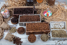 Assorted Coffee Beans. Various Kinds Of Coffee In Box. Assorted Single Origin Gourmet Coffees With Roasted And Raw Beans And Individual Bowls Of Freshly Ground Coffee Over.
