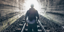 Man Figure On Lingh - End Of Tunnel Concept Stock Photo