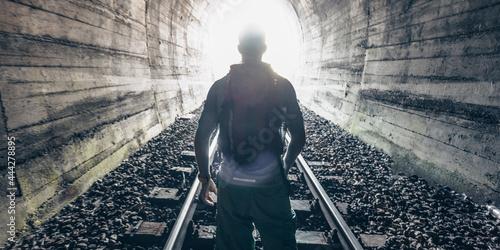 Man figure on lingh - End of Tunnel concept stock photo Fototapeta