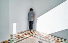 Lonely Sad Kid Standing In Corner